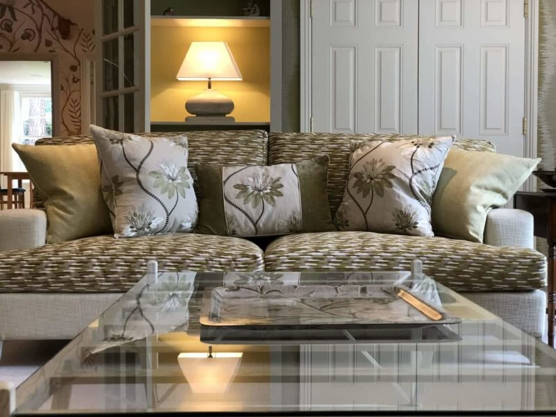 Upholstered sofa with embroidered scatter cushions