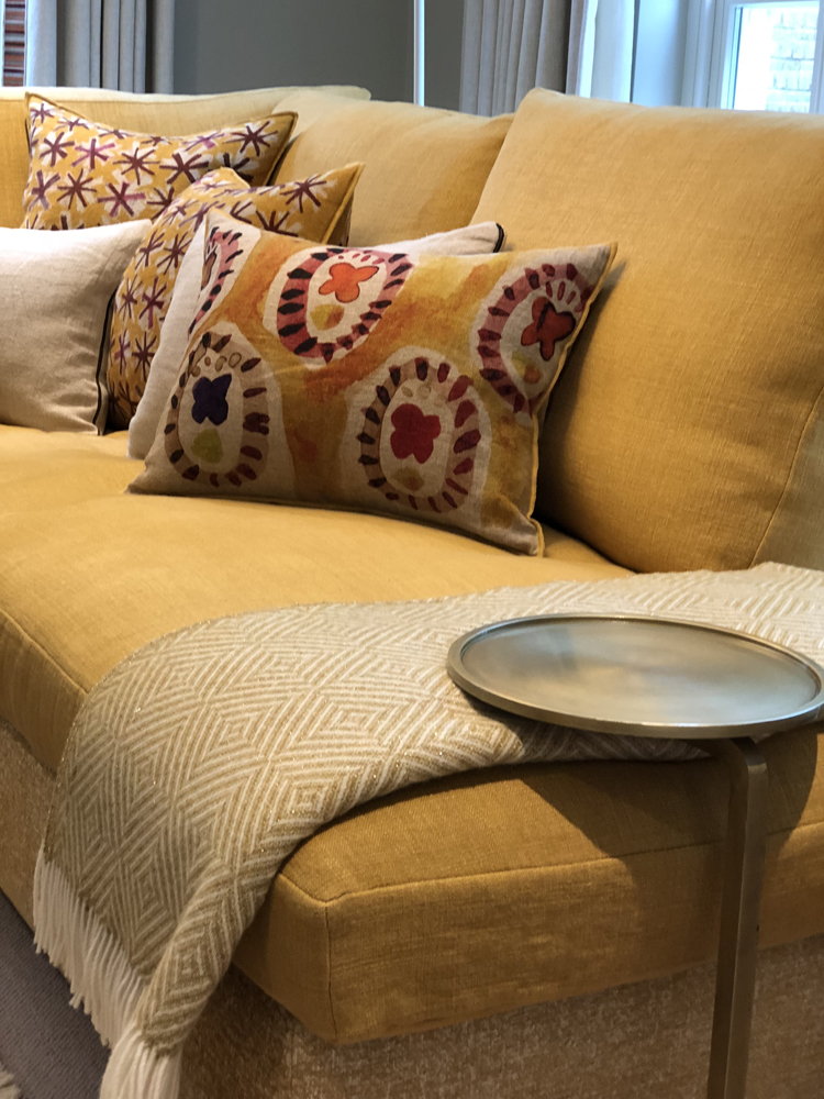 Smart space side table over the seat cushion, cosy throw and cushions