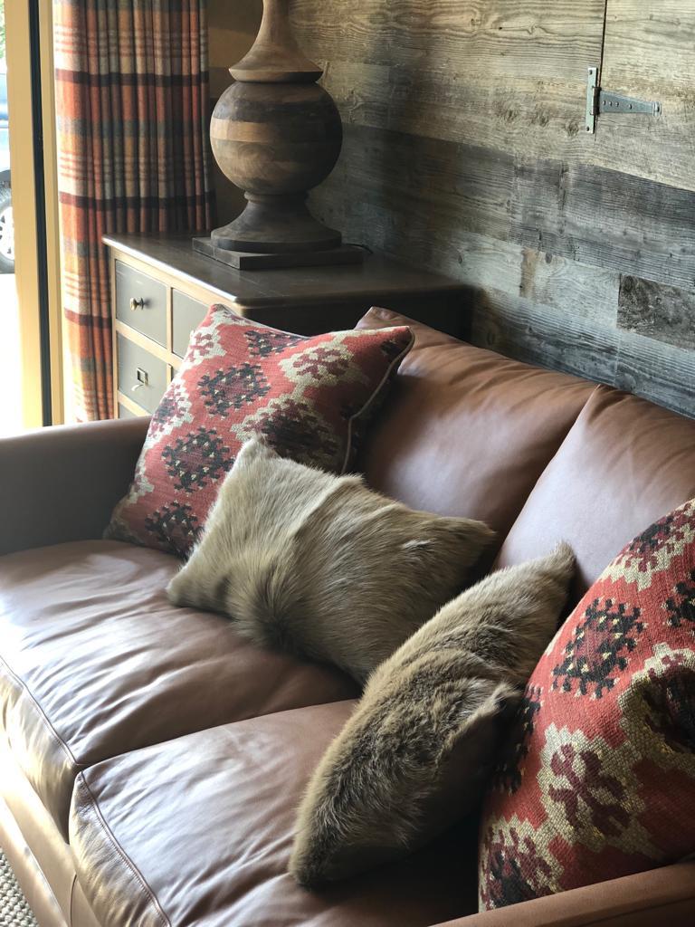 Leather sofa with cosy scatter cushions