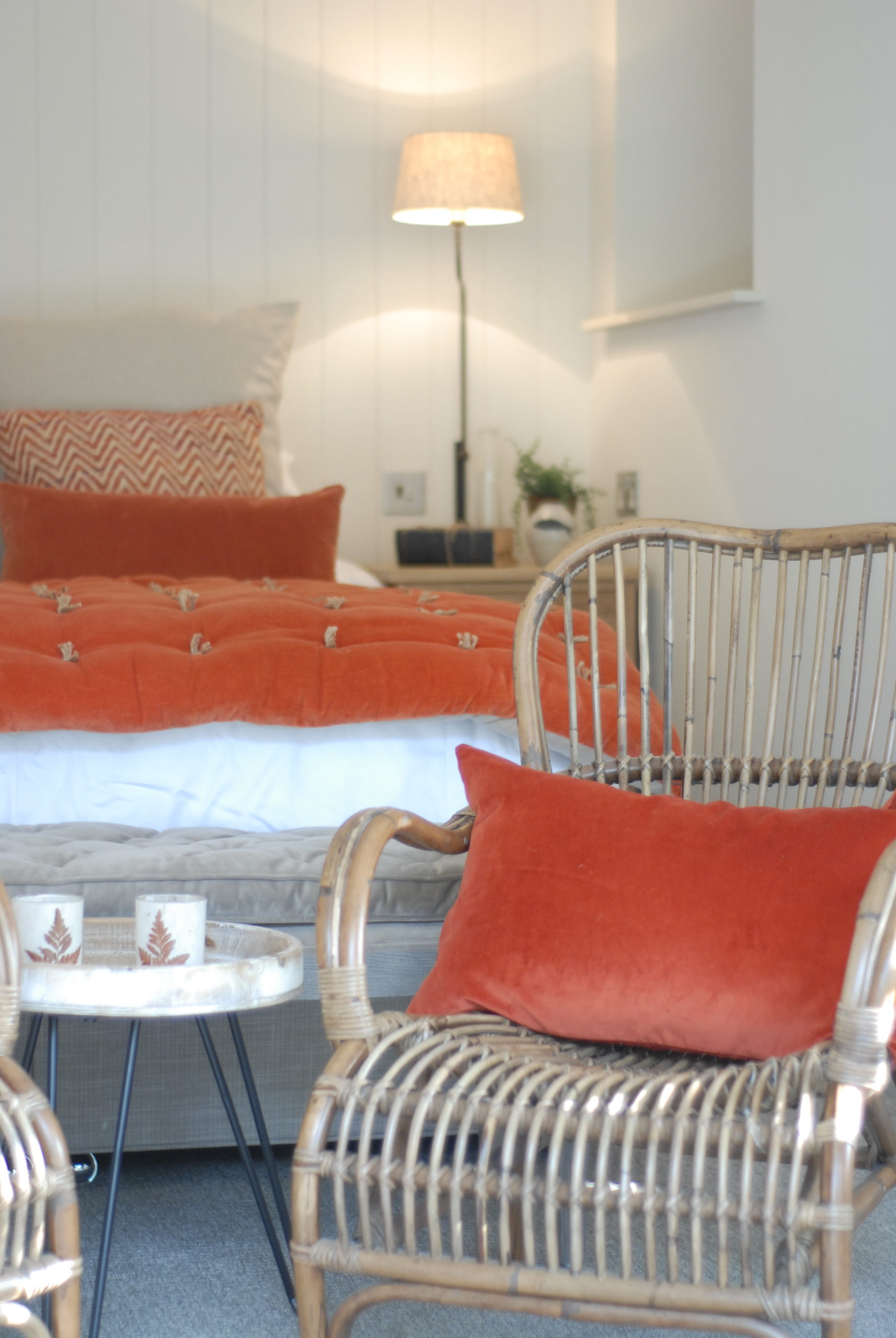 Cosy rattan armchairs with pop of colour